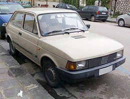SPORT// PLASTICA FANALINO AN FIAT 127  BN SX// LEFT FRONT LIGHT LENS SPECIAL